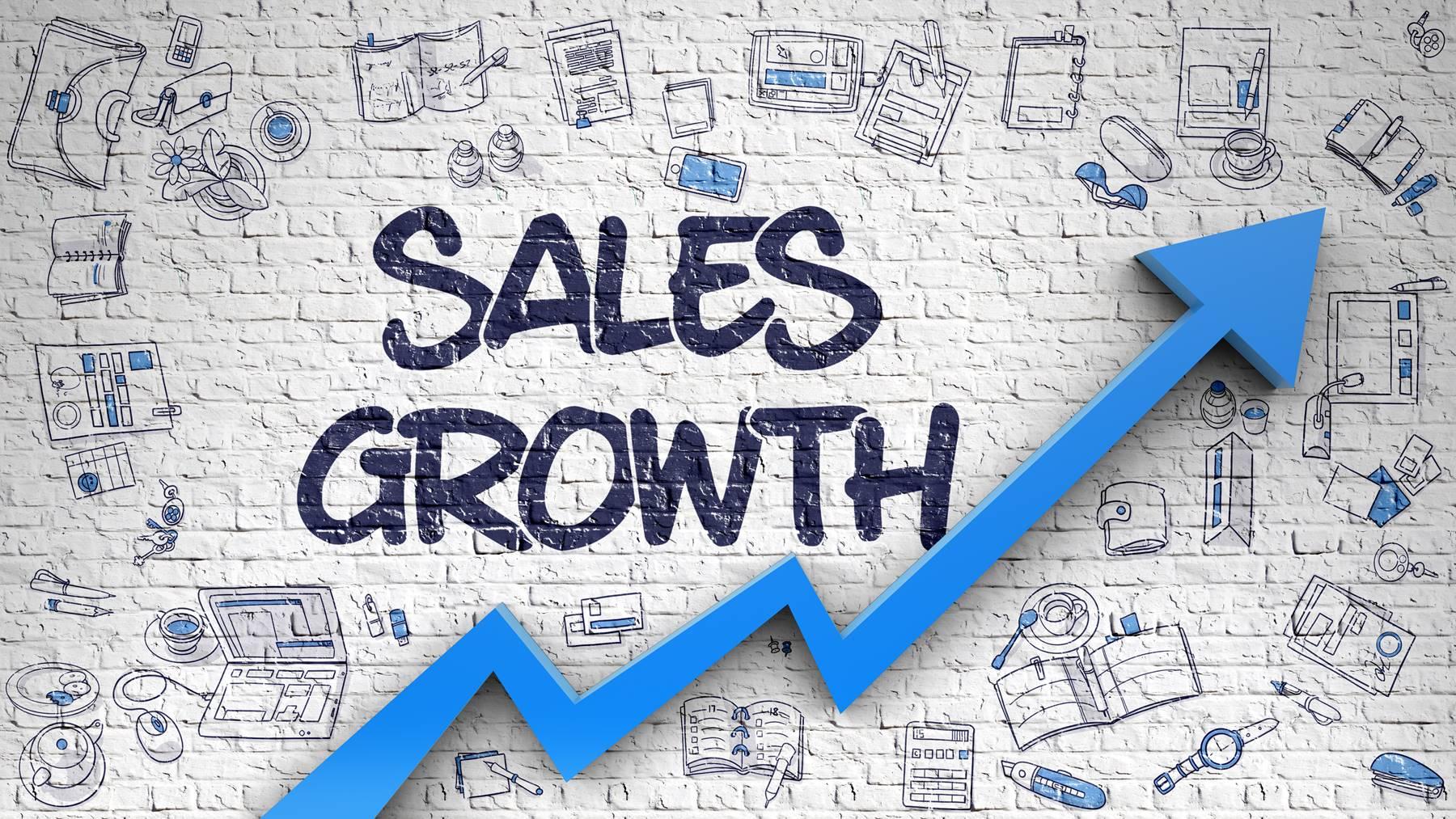 Sales Growth Drawn on Brick Wall.